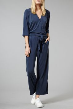Just Female Blue Stone Gandi Jumpsuit: An absolute gem of a signature piece from Just Female. With a real nod to the 70's, it is crafted from a wonderfully modal blend that feels incredible in a design that is super chic. It has a deep V-neck and belt at the waist, with straight legs. One word for this one... fierce!