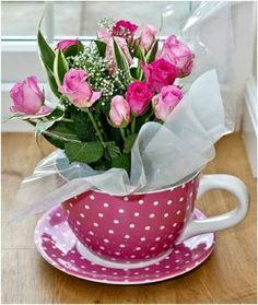 Bouquet of pink roses in a giant spotty pink tea cup. Could easily make your own on a budget as a lot of garden centres or The Range sell these giant tea cup and saucers and supermarkets sell nice bouquets for a fraction of what you'd pay at flower stores Spring Flower Arrangements, Spring Flowers, Floral Arrangements, Pink Tea Cups, Deco Floral, Colorful Roses, Color Rosa, Ikebana, Table Centerpieces