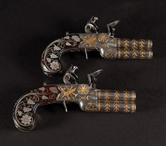 Possibly the Finest Pair of English Gold and Silver Inlaid Flintlock Over and Under Pocket Pistols on the market today! Circa 1800-1810. (1800)