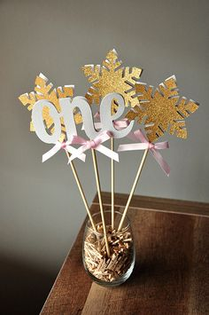 "Love the winter ""one""derland theme for a first birthday!  My little one's party is going to be perfect with these centerpieces."