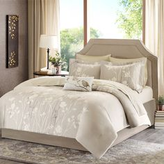 Vaughn brings luxury and beauty to any bedroom. This taupe comforter is covered in elegant white and brown floral tree branches with subtle yellow details. The soft microfiber polyester creates a slight sheen on this comforter and is machine washable for easy care. This complete bed set includes one decorative white pillow which features a beautiful bird applique in gold. Two coordinating shams and a yellow and white sheet set complete the look