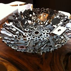 Beautiful bowl I admire every time I'm at this salon, where I get fabulous pedicures. The bowl is made from old tools and hardware. Love it and the live-edge table it's on.
