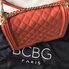 Quilted Purse Classy and sophisticated style, can we worn as crossbody or on shoulder. Single flap with an interior small pocket pictured with an iPad Mini to give an idea of dimensions •NO TRADE• BCBG Bags