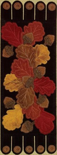 gorgeous fall runner made with black felt and sew on oak leaf shaped suede patches.  I would change the ends to something different...