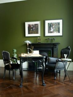 From the UK comes a bit of drama - the minimalistic antique office/study? All black furniture against an olive green wall with pops of whit...