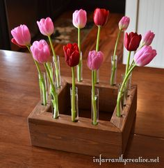 Love this spring-y floral centerpiece (made from 2x4's!) by Infarrantly Creative