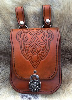 Rustic Hand-Tooled Leather Belt Bag on Etsy, $150.00. The thing about having a belt bag this gorgeous is you HAVE TO have a great belt to wear it on.