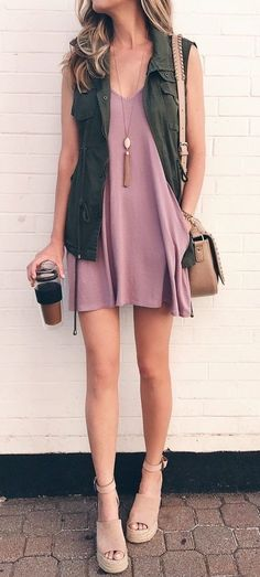Pale pink dress with khaki vest.