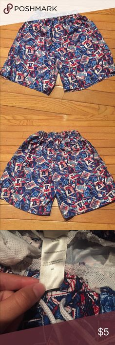 USA patriotic swimming trunks Red, white, & blue trunks. Has pictures of the Liberty Bell, George Washington, Mt. Rushmore, Uncle Sam, & American stamps Swim Swim Trunks