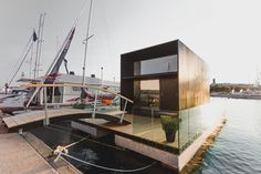 KODA Light Float by Estonian firm Kodasema is a two-story tiny prefab house, installed on a floating pontoon base. Shed To Tiny House, Best Tiny House, Floating House, Floating In Water, Movable House, Floating Pontoon, Zinc Cladding, Tiny Home Cost, Modular Housing