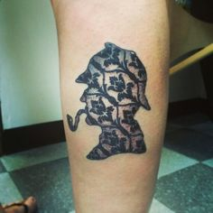 Sherlock Holmes tattoo: I love that it's filled with the style of wallpaper at Baker Street!