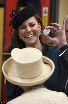 Special gift: The Duchess of Cambridge laughed when she was presented with a Baby On Board badge and promised to wear it at home