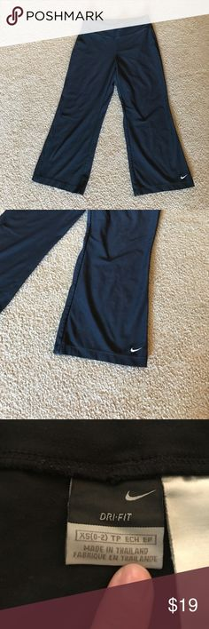 Nike Dry-fit Capri pants XS Good preowned condition. No holes, snags or stains. The black color is a tad bit faded but unless you wear it with a brand new black top, you wouldn't be able to tell. Love these, just don't wear cropped pants anymore. Nike Pants Ankle & Cropped