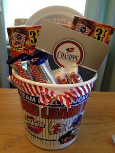 Baseball, softball, or tee ball coach gift:  big league chew bucket with cracker jacks, baby Ruth minis, and Champps gift card.