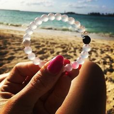 Lokai bracelet. The white bead is injected with water from Mt. Everest and the black with mud from The Dead Sea. The highest and lowest points on earth. Whether you're on top of the world or down on your luck, the lokai bracelet will remind you to be humble, ambitious, and centered.