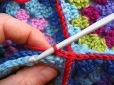 crocheting granny squares together.  I wonder if it would be less obvious if they were slip stitched together.
