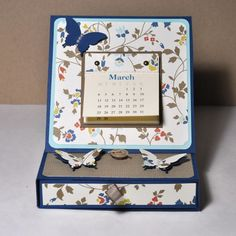 A easel card box made with my favorite paper. Comfort Café and Midnight Muse. The box is filled with 3 cards and envelopes.