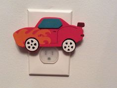 Race Car Outlet Cover.   Protective outlet cover Great Gift for any occasion Great for a nursery or child's room.  Plugs into outlet using safety