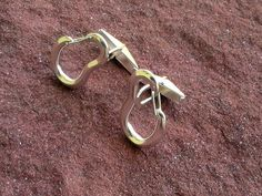 Hey, I found this really awesome Etsy listing at http://www.etsy.com/listing/151336830/climbing-carabiner-cufflinks-sterling