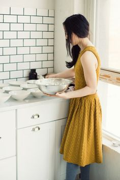 Love the dark grout on the subway tile...-and the dress/tights combo!