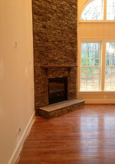 exactly how our fireplace is on a diagonal and windows right next to it - Corner Gas Fireplace Design Ideas
