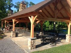 The custom cupola and large stone fireplace are key aspects to this outdoor pavilion.