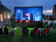 Build a backyard movie theater with these DIY tutorials! Make an outdoor movie screen and even cool chairs for viewing! Best Outdoor Movie Projector, Outdoor Movie Screen, Outdoor Cinema, Outdoor Theater, Backyard Movie Theaters, Backyard Movie Nights, Outdoor Movie Nights, Outdoor Entertaining, Indoor Outdoor