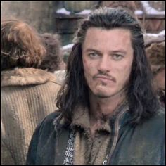 Luke Evans bitting the inside of his lip  just waiting, waiting