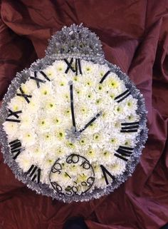Pauline at Dalrimples Florist did a great job creating a pocket watch from a posy pad
