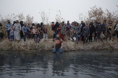 People wait near Nemrud village to cross the Tigris River by small boats, escaping the fight between the Iraqi army and Islamic State militants near Tuebe village, in southeast Mosul, Iraq, on Nov. 2016