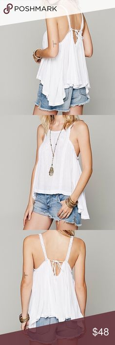 🌟FINAL MARKDOWN🌟 Free People Drapey Tank Free People Drapey Open Back Tank. 100% Rayon. Worn Only Once, in Excellent Condition. This Is a MUST HAVE for any FESTIVAL GOER! Price is Negotiable! Free People Tops Tank Tops