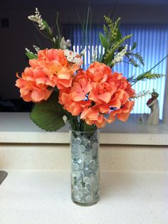 Fake Flower Arrangement, using Dollar store vase, glass pebbles, flowers and greenery.