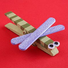 DRAGONFLY MAGNET:  Cute and simple way to create a magnet to display children's artwork.  Paint a wood clothespin to be the body and paint two mini craft sticks to be wings. Once dry, cross the craft sticks on top of the clothespin and glue in place. Add googly eyes to the front and glue a strong magnet to the bottom of the clip.