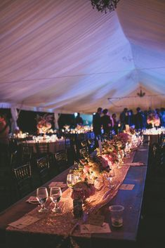 If you're having an outdoor reception under a tent, get soft lighting with the addition of bistro lights.