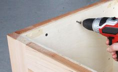 Step Secure your two front and back panels and two side panels of plywood inside of your frame using a drill and wood screws.