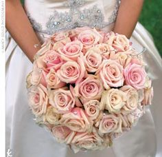Julie carried a French hand-tied bouquet of Sahara roses wrapped in ivory satin ribbon.