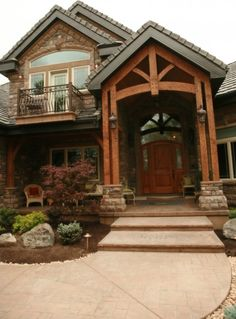 """This looks somewhat like my """"dream home"""". I love the huge wooden archway leading to the stunning front door. The brick work also has a magical, country feeling."""