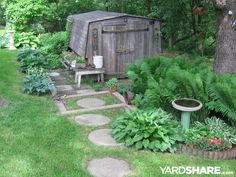Backyard at Whispering Oaks: The circular stones lead to our vintage shed with ferns and hostas growing well under the shade of t
