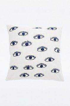 Housse de coussin avec yeux brodés