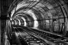 """Black and white photography of an underground tunnel - """"The Subway Tunnel"""" from The Pixoto Collection by Antonio Amen available at Great BIG Canvas."""