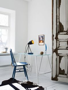 Stylish Scandinavian Home Office Design with white walls, white floor and bare window