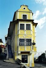 """The Rococo-style """"House of the Good Shepherd"""" was built in 1760 – 1765. It's now home to the Museum of Clocks."""