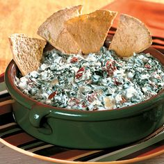 Cheesy Spinach-Artichoke Dip: A crowd-pleasing appetizer made in the slow cooker? Yes, please!