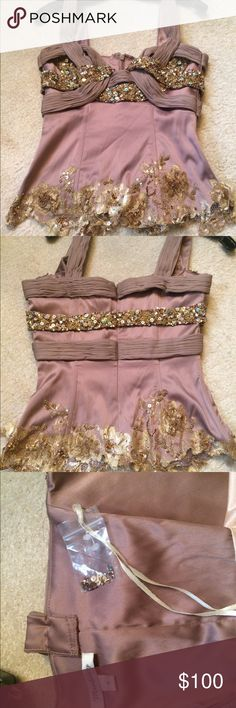 Lavender Mandalay Corset Bustier Sexy deep lavender Mandalay corset bustier never worn. Size 4. Embroidered beaded detail on bottom with fabulous intertwined jeweled bust. Corset wires to flatter figure. Back zipper with hook. Lined. Comes with extra beads and sequins. Slight imperfections (microscopic snag, lace frayed). Mandalay- the sexy designer worn by Paris Hilton, Holly Madison, Eva Longoria, Taylor Swift, & Carmen Electra! Mandalay Tops