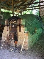 Esthoggama wood-fired kiln, Kohila, Estonia, The project began back in the mid-1990's when Professor Richard Spiller from East Carolina, USA, suggested the possibility of building a wood-fired kiln in Estonia.  Then in 1998 a collection was made during a Wood-fire conference in the States to help build the kiln.  In 2000 potters from Seagrove, North Carolina, received funding from Art Link and travelled to Estonia to assist with the kiln building.