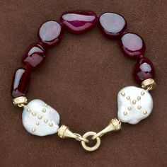 Breane Bracelet    Six raw polished rubies with gold studded baroque pearl caps and Mahlia hook