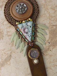 Wooden button and feathers Necklace by HeidiKummliDesigns on Etsy