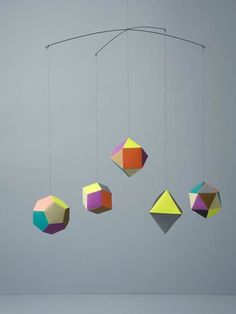 """Themis Mobile designed by Clara von Zweigbergk for Artecnica. von Zweibergk calls it """"a nano universe of geometric shapes. Handmade Baby Items, Handmade Wooden, Mobiles, Douglas And Bec, The Home Edit, Stationery Paper, Elements Of Art, Mobile Design, Geometric Shapes"""