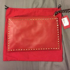 Valentino Garavani rockstud clutch Brand new classic Valentino rockstud clutch, red leather with gold hardware. Interior zip compartment and two open pockets. Comes with dust bag and cards. Approximately 13.5W x 8.75H inches. I almost don't want to sell it! Valentino Bags Clutches & Wristlets