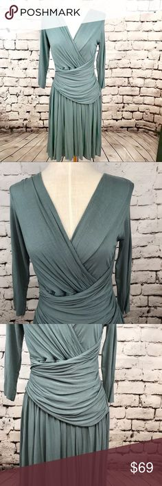 "Bailey 44 3/4 Sleeve V-Neck Ruched Draped Dress Absolutely stunning Bailey 44 dress in a sage or jade color. Features v-neck styling and gorgeous ruching and draping at waist and skirt. 3/4 sleeves. 94% rayon 6% spandex. Armpit to armpit is approx 17.5"" and length is approx 37.25"" Bailey 44 Dresses"